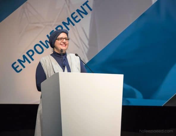Elena Muslim Travel Girl standing at podium empowerment Islam