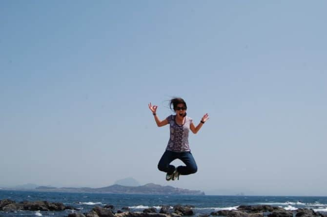 Susan Shain jumping in the air in South Korea having fun traveling the world with seasonal jobs