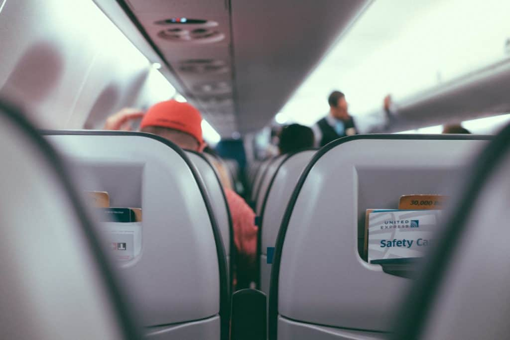 View of the inside of an airplane from the passenger seat