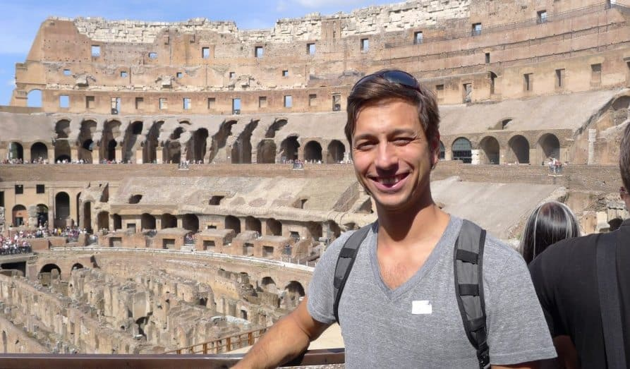 Jason Moore standing in the Roman Colosseum
