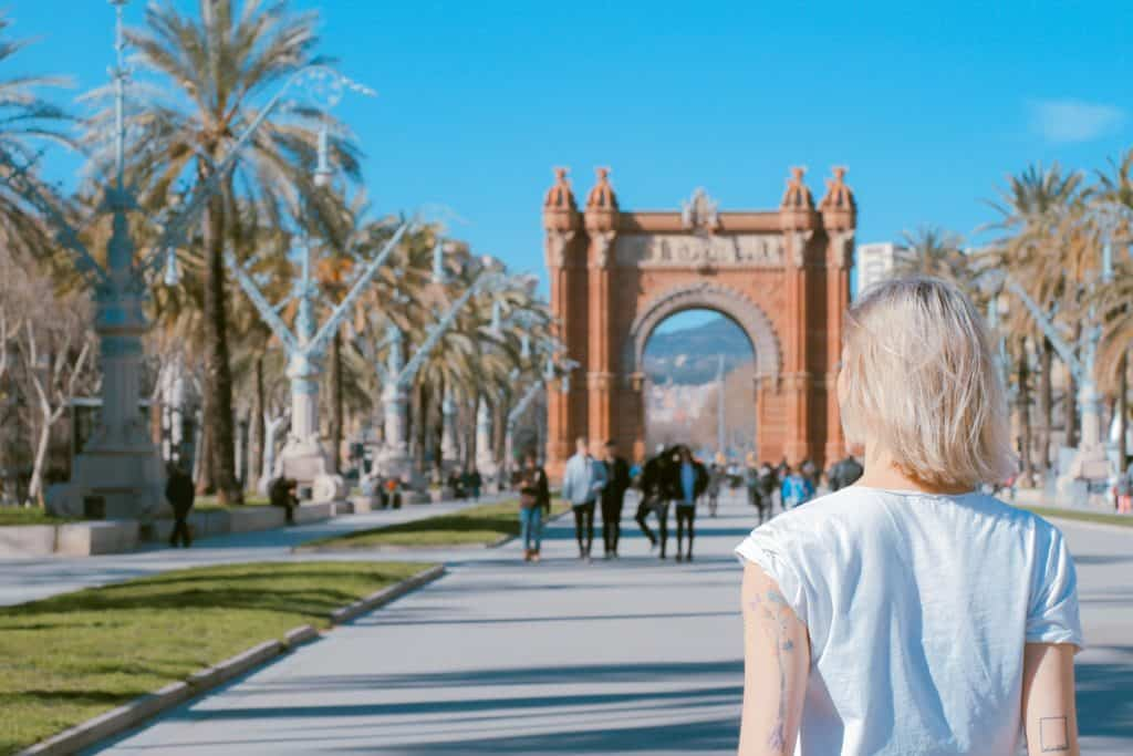 traveler standing near arch in Barcelona